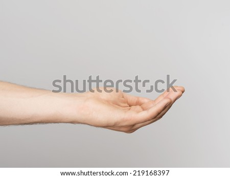 Outstretched human hand - stock photo