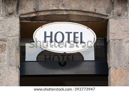 Oval Hotel Sign above the entrance of a Accommodation in Brittany, France - stock photo