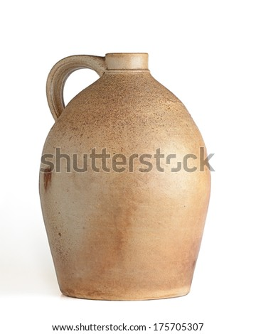 Oval shaped tan and yellow clay jug with handle, white background, angular view. - stock photo
