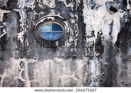 oval window on the old wall - stock photo
