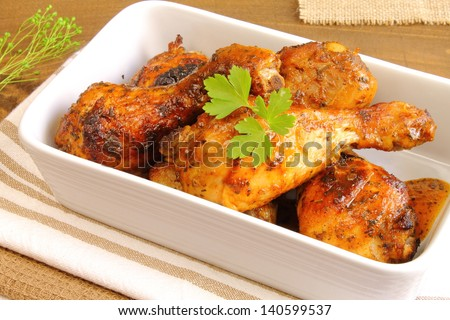 Oven baked chicken thighs - stock photo