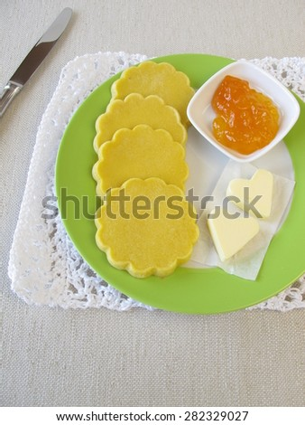 Oven baked gluten-free maize pancakes with butter and jam - stock photo