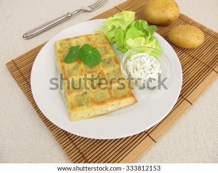 Oven-baked potato waffles with cream cheese dip and salad - stock photo