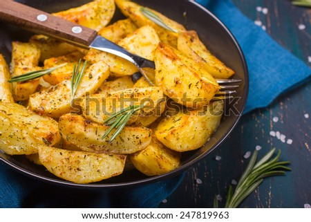 Oven Baked potatoes with herbs - stock photo