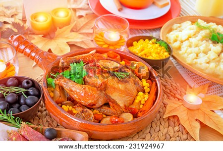 Oven roasted Thanksgiving Turkey on centerpiece of beautiful decorated festive table, healthy and tasty family dinner, traditional autumn holiday - stock photo