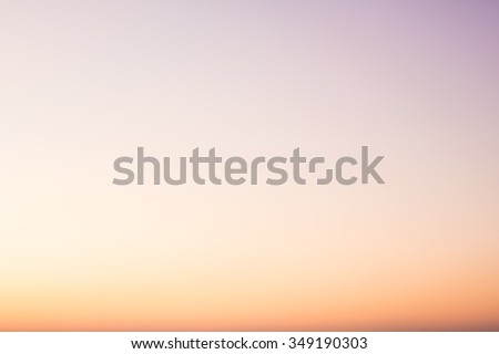Over blur beautiful colorful sunset above sea and could sky texture background with boat and sun shine. color pink, blue, yellow, white pattern concept. - stock photo