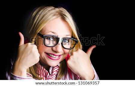 Over Excited Nerd Expresses Geeky Grin When Thumbing To Black Copyspace With Both Thumbs Up - stock photo