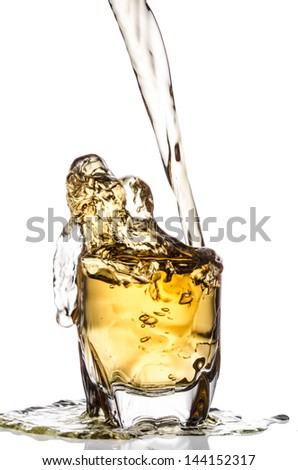 over flow pouring whiskey isolated on white background - stock photo