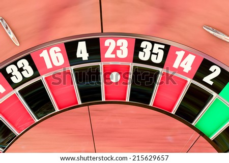 Over head sot of an American roulette wheel winning number twenty three - stock photo