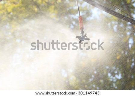 Over head sprinkler for agriculture. - stock photo
