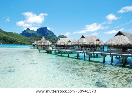 over water bungalow and otemanu mountain - stock photo