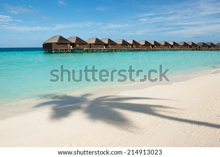 Over water bungalows, beach of Maldives - stock photo