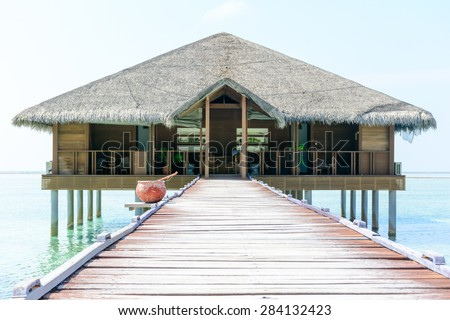 Over water hut and jetty at a resort in Maldives - stock photo