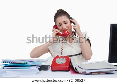 Overburden businesswoman answering the phones against a white background - stock photo