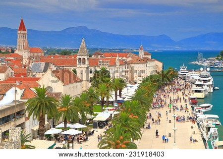 Overcast day with buildings of an old Venetian town near the Adriatic sea, Trogir, Croatia - stock photo