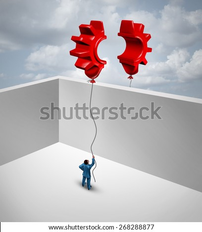 Overcome business barriers as two partners separated by walls in a joint effort to merge two flying red balloons shaped as half a gear or cog as a symbol for trade success and global trade solutions. - stock photo