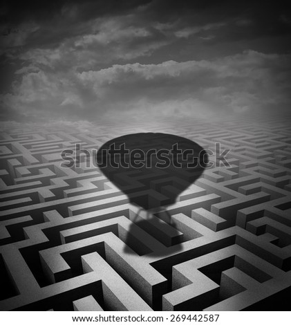 Overcome obstacles concept as a hot air balloon cast shadow on a maze or labyrinth as a motivational business metaphor for rising above challenges incorporating innovative solutions. - stock photo