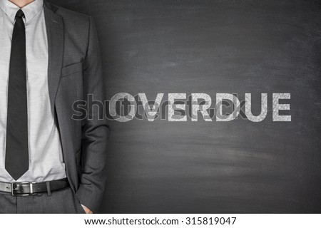 Overdue text on black blackboard with businessman - stock photo
