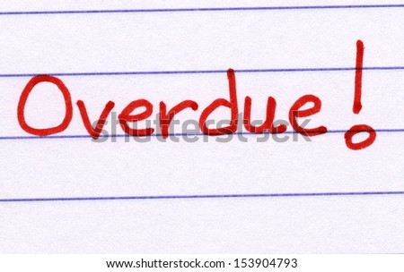 Overdue, written in red ink on white paper. - stock photo