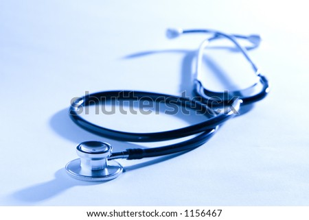 Overexposed Dual Head Stethoscope backlit with strong light. - stock photo