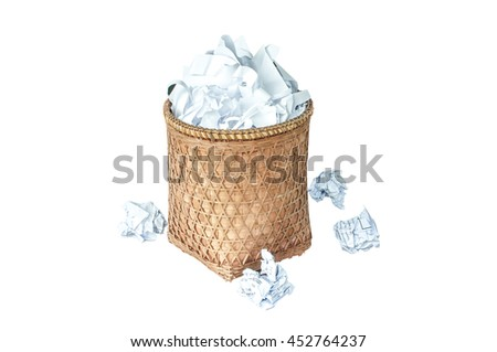 Overflowing waste paper in garbage bin, wastepaper in rubbish isolated on white background  - stock photo