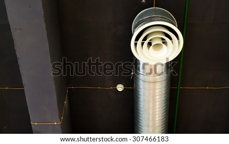 Overhead air vent forms part of the air conditioning for a modern building - stock photo