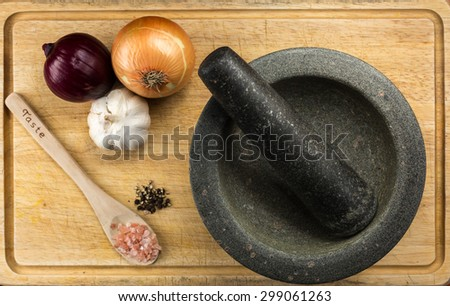 Overhead Food Shot with mortar and pestle on Cutting Board - stock photo