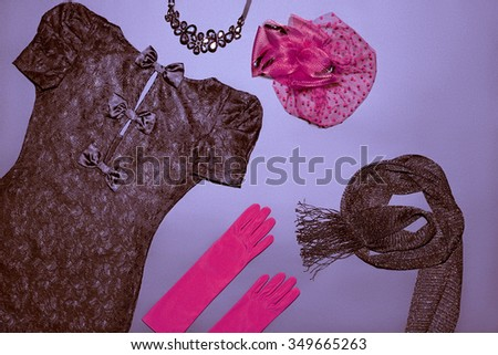 Overhead outfit Top view. Fashion clothes stylish set, little black lace dress, accessories. Glamor creative, red hat, gloves, necklace, scarf. Unusual elegant evening party essentials. Vintage retro - stock photo