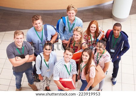Overhead Portrait Of College Students Standing In Hallway - stock photo
