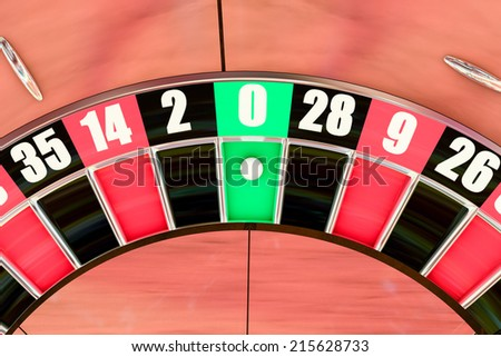 Overhead shot of an American roulette wheel winning number zero - stock photo