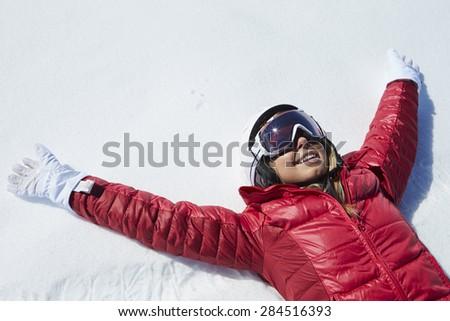 Overhead Shot Of Girl Having Fun On Winter Holiday - stock photo