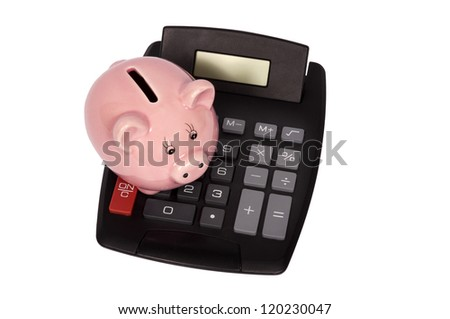 Overhead shot of piggy bank setting on top of calculator.  Isolated on white. Vertical shot. - stock photo