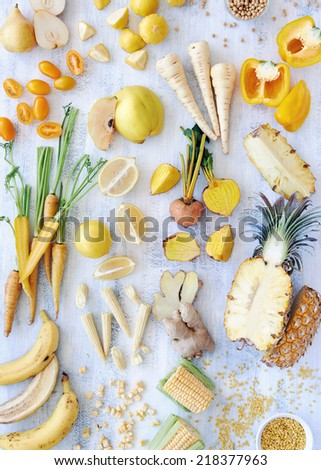 Overhead shot of sliced up yellow raw and organic food - stock photo
