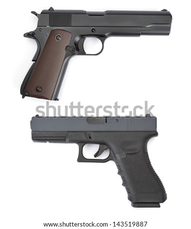 Overhead shot of two different pistols isolated on a white background - stock photo