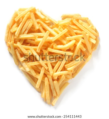 Overhead Still Life of Thin Straight Cut French Fries in Shape of Assymmetrical Heart on White Background - stock photo