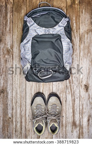 overhead view of a backpack and hiking boots. - stock photo