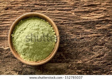 Overhead view of a bowl of finely ground green tea powder, or matcha, used as an Asian beverage especially in Japanese tea ceremonies and also as a flavouring in food - stock photo