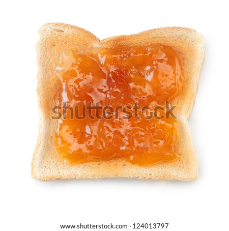 Overhead view of a slice of white toast topped with vibrant orange apricot or peach jam - stock photo
