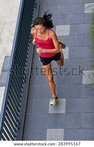 overhead view of active sporty woman training outdoors for marathon run in morning - stock photo