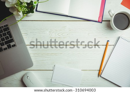 Overhead view of an desk with electronic devices - stock photo