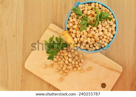 Overhead view of chick peas, Hummus on a wooden background - stock photo