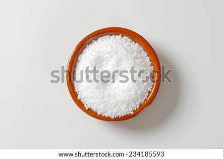 overhead view of coarse grained salt in the ceramic bowl - stock photo