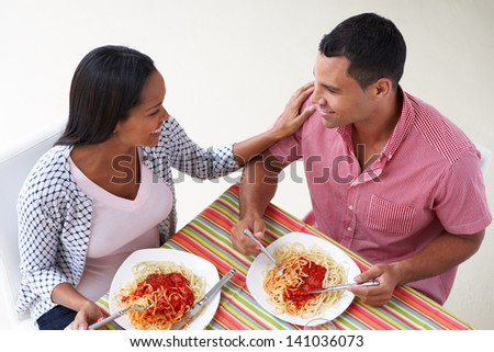 Overhead View Of Couple Eating Meal Together - stock photo