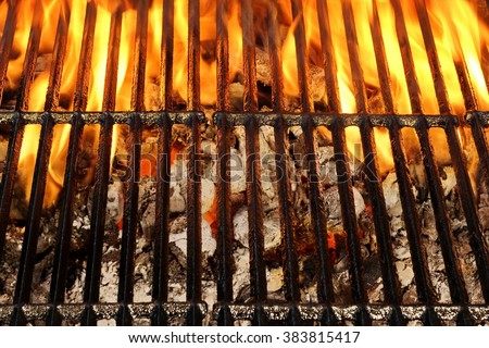 Overhead View Of Empty BBQ Hot Fire Grill And Burning Charcoal Briquettes With Bright Flames. Outdoor Scene. Concept for Summer Party Or Picnic Or Cookout. Isolated Black Background. Close Up - stock photo