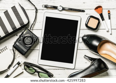Overhead view of essential items for business women, Top view of Tablet and female accessories - stock photo