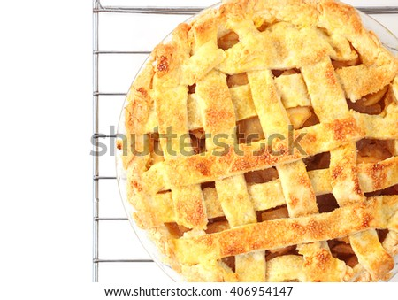 Overhead view of homemade apple pie topped with a lattice crust - stock photo