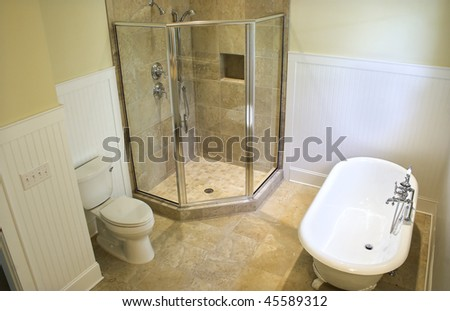 overhead view of luxury bathroom with clawfoot tub and shower - stock photo