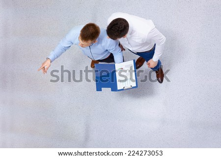 overhead view of people having business meeting. - stock photo