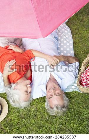 Overhead View Of Senior Couple Enjoying Picnic Together - stock photo