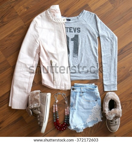 Overhead view of women's/girl's fashion with accessories. A hip outfit for girls. - stock photo